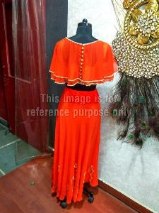 Bright Orange Coloured Crop Top With Matching Skirt